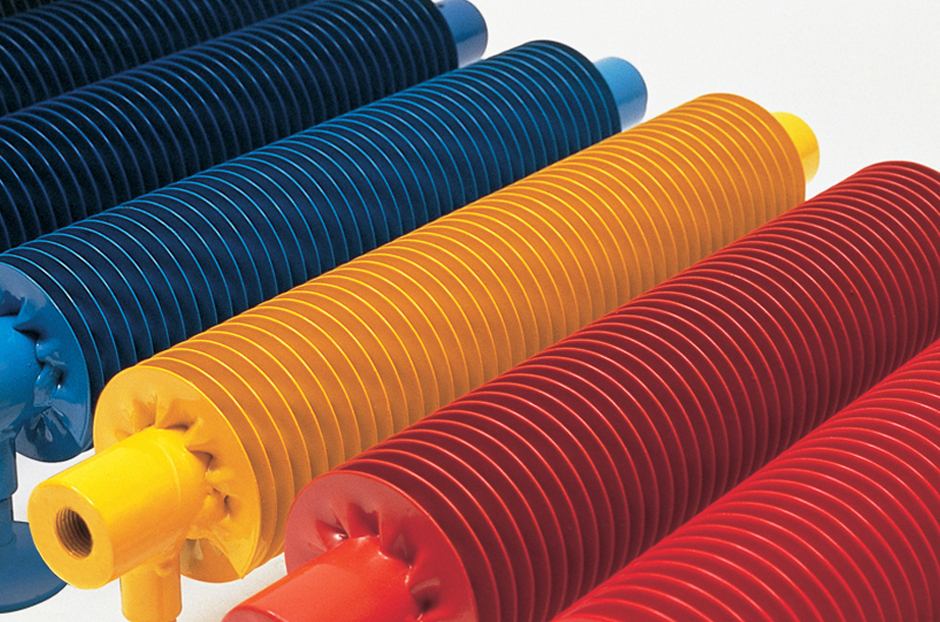 Radiators shown are central heating versions in Traffic Blue, Steel Blue, Traffic Yellow and Flame Red